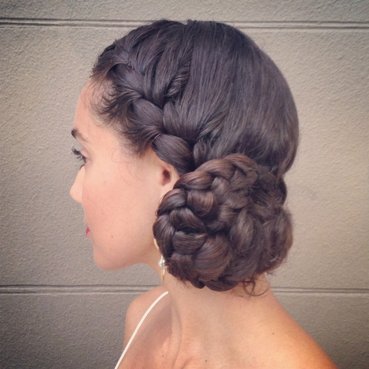 braided side bun on naturally curly hair
